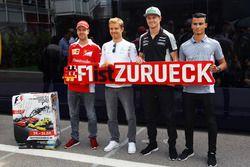 (L to R): Sebastian Vettel, Ferrari; Nico Rosberg, Mercedes AMG F1; Nico Hulkenberg, Sahara Force India F1; and Pascal Wehrlein, Manor Racing, promote the return of the German Grand Prix