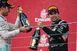 (L to R): Race winner Nico Rosberg Mercedes AMG F1 celebrates on the podium with third placed Sergio