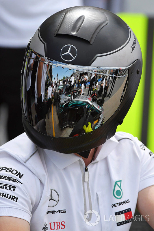 McLaren mechanic with reflection in helmet