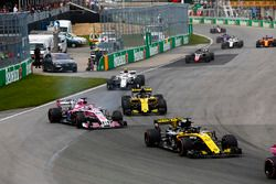 A sideways Sergio Perez, Force India VJM11, battles with Carlos Sainz Jr., Renault Sport F1 Team R.S