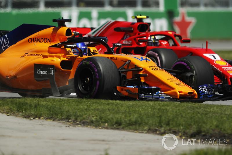 Fernando Alonso, McLaren MCL33, et Kimi Raikkonen, Ferrari SF71H
