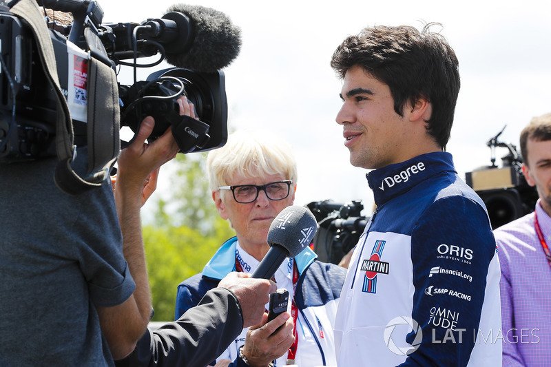 Lance Stroll, Williams Racing, speaks to the media as PR Anne Bradshaw watches on