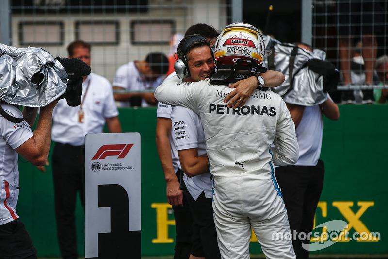 Lewis Hamilton, Mercedes AMG F1 celebrates pole position in Parc Ferme with his team