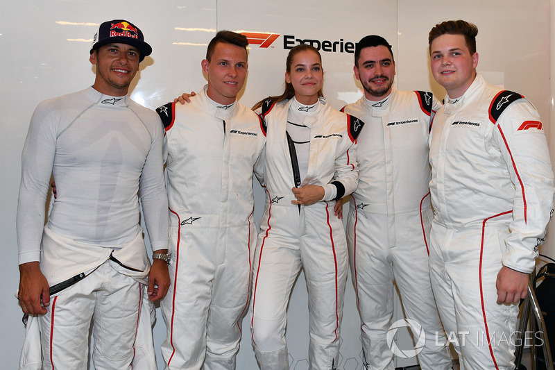 Patrick Friesacher, F1 Experiences 2-Seater driver, F1 Experiences 2-Seater passenger Barbara Palvin, and F1 Experiences 2-Seater passengers