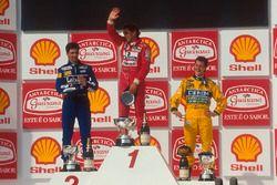 Podium: Race winner Ayrton Senna, McLaren, second place Damon Hill, Williams, third place Michael Sc