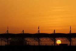 The sunset behind a grandstand