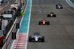 Felipe Massa, Williams FW40, leads Fernando Alonso, McLaren MCL32