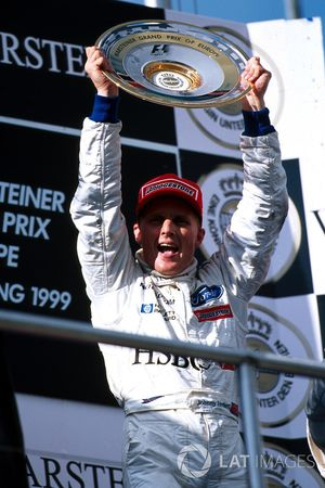 Podium: race winner Johnny Herbert, Stewart Grand Prix
