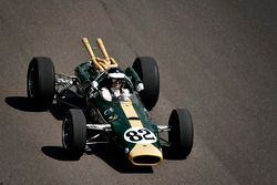 Dario Franchitti driving Colin Chapman designed 1965 Lotus 38, the first mid-engined car to win the Indianapolis 500 driven to victory by Jim Clark