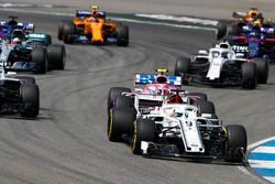 Marcus Ericsson, Sauber C37, leads Esteban Ocon, Force India VJM11, Lewis Hamilton, Mercedes AMG F1 W09, and Lance Stroll, Williams FW41