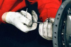 Ferrari mechanic at work on the F310