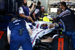 Engineers work on Sergey Sirotkin, Williams FW41
