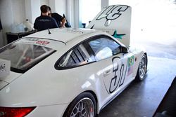 Crews work on the #31 MP1B Porsche GT3 Cup of Alan Hellmiester, Adalberto Baptista, Luca Seripiere,