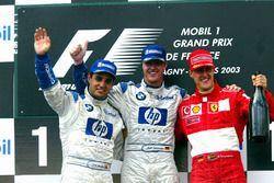 Podium: second place Juan Pablo Montoya, Williams, Race winner Ralf Schumacher, Williams, third place Michael Schumacher, Ferrari
