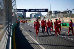 Sebastian Vettel, Ferrari and Maurizio Arrivabene, Ferrari Team Principal walk the track
