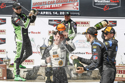 Podium: second place Scott Sharp, Ryan Dalziel, Tequila Patron ESM, winners Joao Barbosa, Filipe Albuquerque, Action Express Racing, third place Renger van der Zande, Jordan Taylor, Wayne Taylor Racing