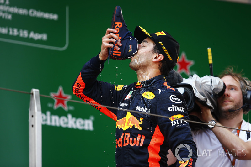 "Race winner Daniel Ricciardo, Red Bull Racing, drinks a champagne ""shoey"" on the podium"