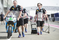 Matt pushing Morbidelli's Marc VDS Honda to scrutineering