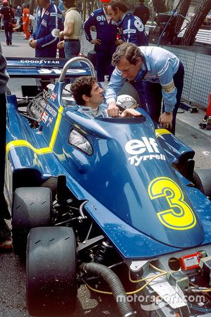 Jody Scheckter, Tyrrell P34-Ford Cosworth, talks with designer Derek Gardner, in the pit lane