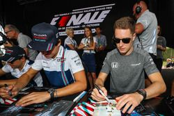 Lance Stroll, Williams and Stoffel Vandoorne, McLaren sign autographs for the fans