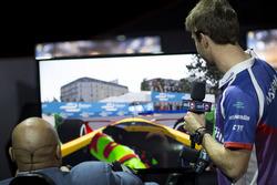 Antonio Felix da Costa, Amlin Andretti Formula E Team, gives advice to a basketball legend