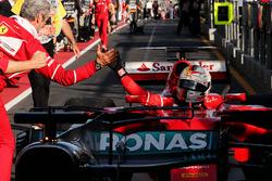 Race winner Sebastian Vettel, Ferrari SF70H celebrates with Maurizio Arrivabene, Ferrari Team Principal in parc ferme