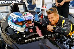 Mika Hakkinen takes Sergio Perez, Force India, forn a ride