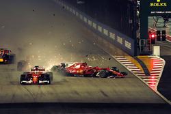 Sebastian Vettel, Ferrari SF70H leads at the start of the race and the cars of Kimi Raikkonen, Ferrari SF70H and Max Verstappen, Red Bull Racing RB13 crash after colliding
