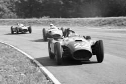 Juan Manuel Fangio, Lancia-Ferrari D50, leads Stirling Moss, Maserati 250F and Peter Collins, Lancia