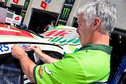 A Hendrick Motorsports places a Nicky Hayden decal on the car of Kasey Kahne, Hendrick Motorsports C