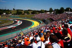 Fans watch Sebastian Vettel, Ferrari SF70H, lead Kimi Raikkonen, Ferrari SF70H