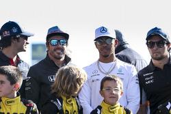 Carlos Sainz Jr., Scuderia Toro Rosso, Fernando Alonso, McLaren, Lewis Hamilton, Mercedes AMG F1, Sergio Perez, Force India, some junior Kart racers