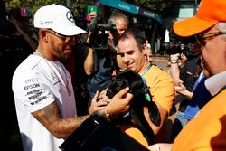 Lewis Hamilton, Mercedes AMG, meets a fan with a dog