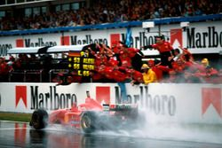 Winner Michael Schumacher, Ferrari F310 takes the flag
