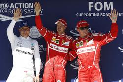 Polesitter Sebastian Vettel, Ferrari, second place Kimi Raikkonen, Ferrari, third place Valtteri Bottas, Mercedes-Benz F1