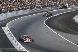 Niki Lauda, Ferrari 312B3, leads Ronnie Peterson, Lotus 72E Ford