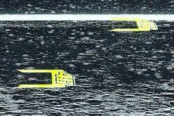 Valentino Rossi marcas pit lane Warm Up con lluvia