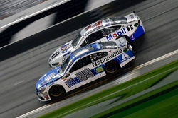 Clint Bowyer, Stewart-Haas Racing Ford, races Dale Earnhardt Jr., Hendrick Motorsports Chevrolet