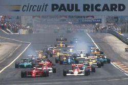 Nigel Mansell, Ferrari 641 leads Gerhard Berger, McLaren MP4/5B Honda, Ayrton Senna, McLaren MP4/5B Honda, Alessandro Nannini, Benetton B190 Ford, Alain Prost, Ferrari 641, Riccardo Patrese, Williams FW13B Renault and Ivan Capelli, Leyton House CG901 Judd