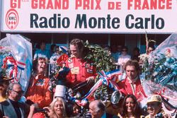 Podium: winner Niki Lauda, Ferrari, second place James Hunt, Hesketh Ford, third place Jochen Mass, McLaren Ford