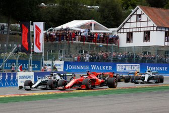 Sebastian Vettel, Ferrari SF90, leads Lewis Hamilton, Mercedes AMG F1 W10, Valtteri Bottas, Mercedes AMG W10