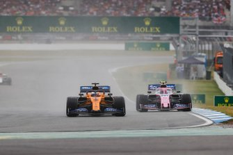 Carlos Sainz Jr., McLaren MCL34, leads Lance Stroll, Racing Point RP19