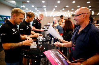 Kevin Magnussen, Haas F1 Team signs an autograph for a fan