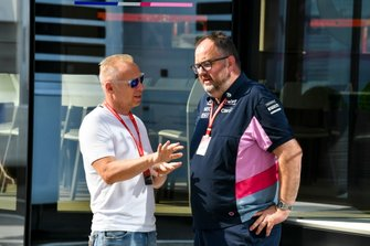Businessman Dmitry Mazepin talks with Tom McCullough, Race Engineer, Racing Point