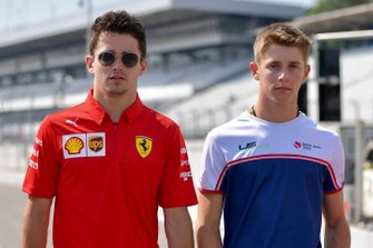 Charles Leclerc, Ferrari walks the track with his brother Arthur Leclerc