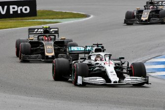 Lewis Hamilton, Mercedes AMG F1 W10, leads Kevin Magnussen, Haas F1 Team VF-19, and Romain Grosjean, Haas F1 Team VF-19