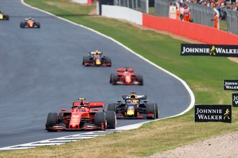 Charles Leclerc, Ferrari SF90, leads Max Verstappen, Red Bull Racing RB15, Sebastian Vettel, Ferrari SF90, and Pierre Gasly, Red Bull Racing RB15