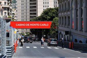 Sir Philip Green crosses the street in Monaco