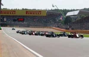 Charles Leclerc, Ferrari SF21, Lewis Hamilton, Mercedes W12, Valtteri Bottas, Mercedes W12, and the rest of the field