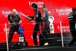 Gianpiero Lambiase, Race Engineer, Red Bull Racing, Sergio Perez, Red Bull Racinga, 3rd position, Max Verstappen, Red Bull Racing, 1st position, and Lewis Hamilton, Mercedes, 2nd position, spray Champagne on the podium